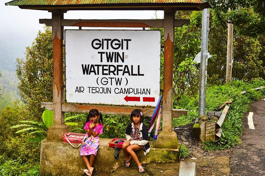 Girls selling souvenirs Gitgit Waterfall - Bali Holiday Secrets